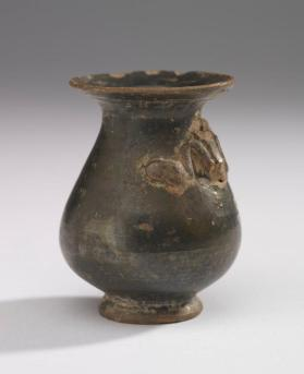 Miniature jug with broken snake-shaped handle