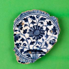 Blue and white dish with floral design (fragment)