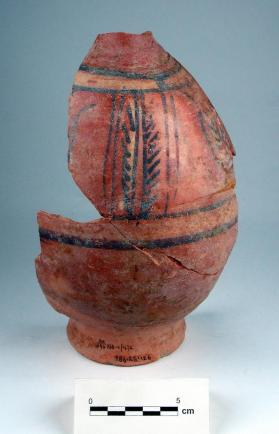 Bottle with painted decoration of horizontal bands and vertical foliage