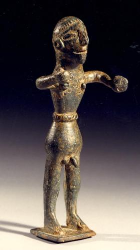 Figure of a warrior holding weapons