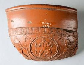 Fragment of a Samian ware bowl with panels depicting Hercules and a satyr