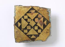 Tile with stylized cross